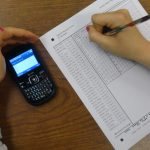 students cheat in exam with cellphone